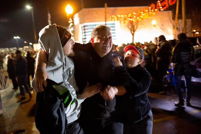 Protesters tend to an activist who was maced at a protest in Ferguson in 2014. Photograph: Aaron P Bernstein/Getty Images