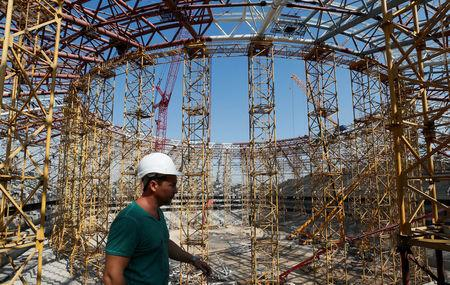 A construction worker walks at Samara Arena stadium under construction in Samara, Russia August 23, 2017. REUTERS/Maxim Shemetov