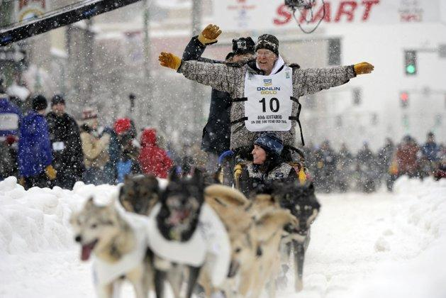 Jeff King waves at race fans on 4th Avenue during the ceremonial start of the Iditarod trail sled dog race, Saturday, March 3, 2012, in Anchorage, Alaska.