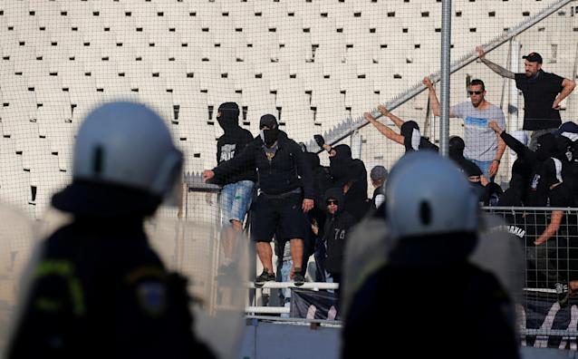 Soccer Football - Greek Cup Final - AEK Athens vs PAOK Salonika - Athens Olympic Stadium, Athens, Greece - May 12, 2018 Police and PAOK Salonika fans look on before the match REUTERS/Alkis Konstantinidis
