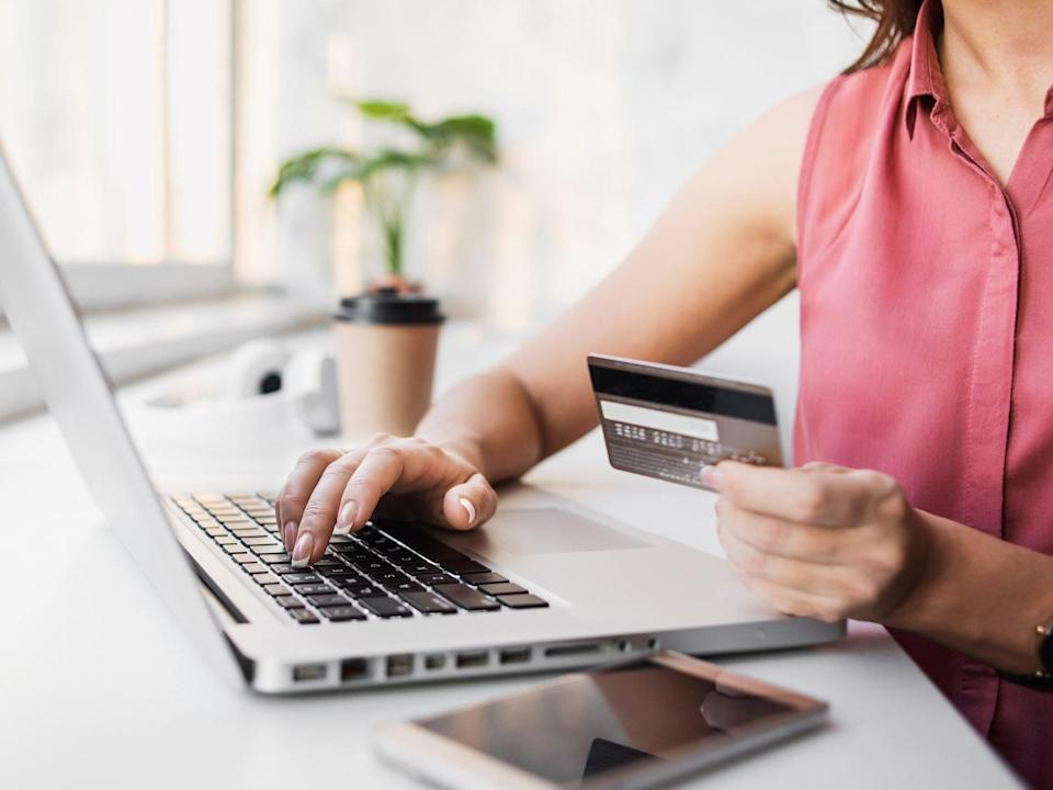impulse-buying: woman shopping online with laptop and credit card