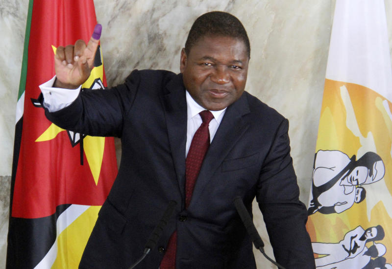 FILE - In this Tuesday, Oct. 15, 2019 file photo, Mozambican President Felipe Nyusi poses at a polling station where he cast his vote in Maputo. Nyusi is to be sworn in Wednesday, Jan. 15, 2020 for a second and final term in Maputo after five turbulent years in office and facing two armed insurgencies as well as economic opportunities. (AP Photo/Ferhat Momade/File)
