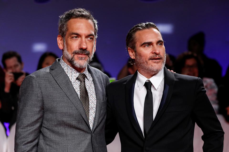 """Director Todd Phillips and Joaquin Phoenix pose at the premiere of """"Joker"""" at the Toronto International Film Festival (TIFF) in Toronto, Ontario, Canada September 9, 2019. REUTERS/Mario Anzuoni"""