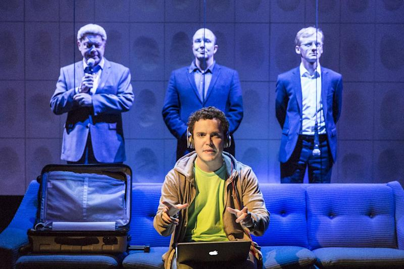 """In this undated handout photograph made available by The Donmar Warehouse theatre, actor Joshua McGuire performs during the play 'Privacy' by James Graham in London. """"Privacy,"""" a new drama that has London buzzing, is probably the first play to open with a request that audience members keep their smartphones switched on, rather than off. It's certainly the first to have theatergoers snapping selfies midway through the first act. By the end, they may be tempted to throw those phones out the window. (AP Photo/Johan Persson) NO SALES"""