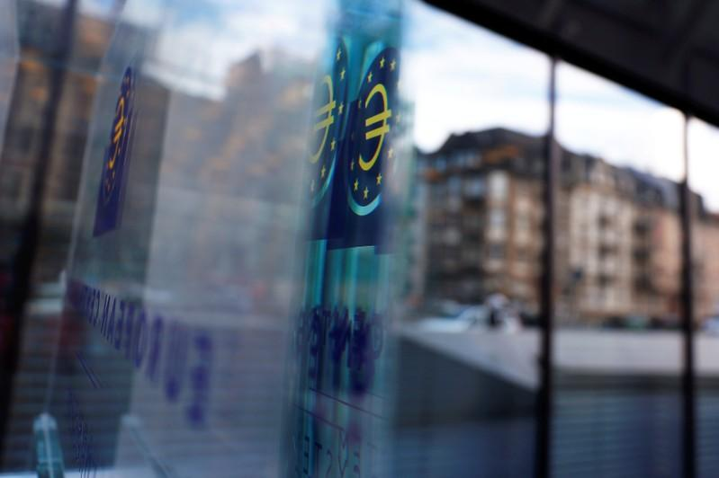 FILE PHOTO: Reflection of the sign of the European Central Bank (ECB) is seen ahead of the news conference on the outcome of the Governing Council meeting, at the ECB headquarters in Frankfurt