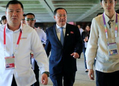 FILE PHOTO: North Korean Foreign Minister Ri Yong-ho walks as he exits after a courtesy call with Philippine President Rodrigo Duterte for the 50th ASEAN Foreign Ministers' Meeting at the Philippine International Convention Center in Pasay city, met