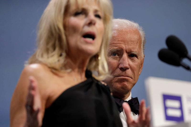 Former Vice President Joe Biden listens to his wife Jill Biden as she addresses the Human Rights Campaign dinner in Washington, D.C., last year. (Yuri Gripas/Reuters)