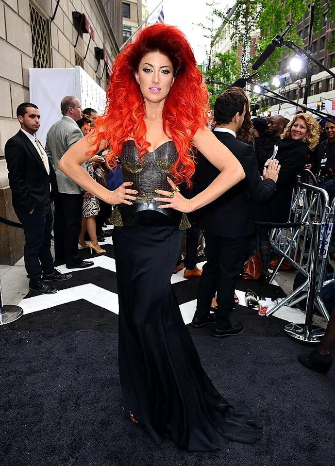 Following in Kelly's footsteps at the E! upfronts was dance diva Neon Hitch, who channeled her inner (and less-interesting) Lady Gaga for a stroll down the arrivals line. (4/30/2012)