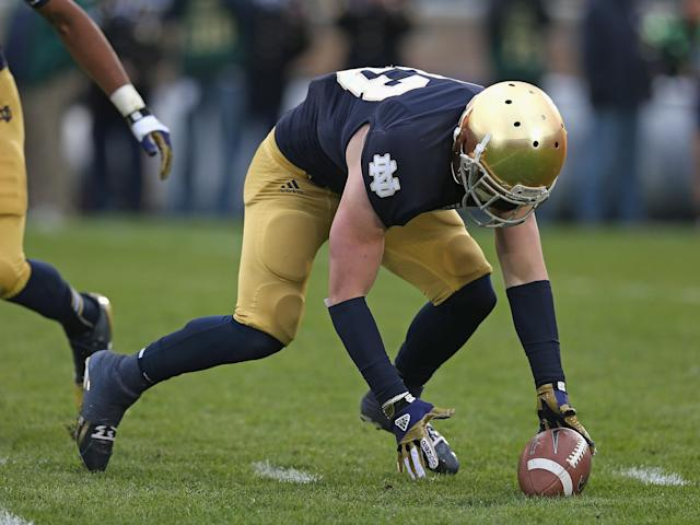 SOUTH BEND, IN - NOVEMBER 03: Cam McDaniel #33 of the Notre Dame Fighting Irish has trouble handling a kick-off against the Pittsburgh Panthers at Notre Dame Stadium on November 3, 2012 in South Bend, Indiana. (Photo by Jonathan Daniel/Getty Images)