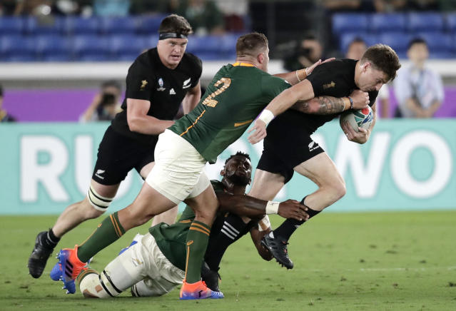 New Zealand's Beauden Barrett, right, attempts to break the tackle of South Africa's Malcolm Marx during the Rugby World Cup Pool B game at International Stadium between New Zealand and South Africa in Yokohama, Japan, Saturday, Sept. 21, 2019. (AP Photo/Jae Hong)