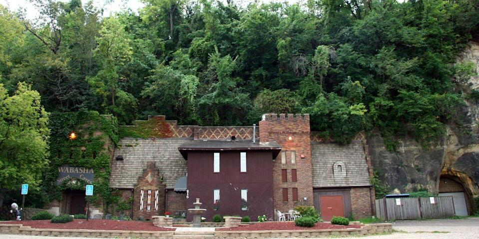 """<p><strong>Wabasha Street Caves - St. Paul, MN</strong></p><p>The sandstone caves located near Saint Paul date back to the 1840s. They were once used for mining, but today they are simply for touring. An event space has been added to the entrance of the tunnels, but that doesn't stop the spirits who still haunt one of <a href=""""https://www.cbsnews.com/pictures/the-most-haunted-places-in-america/2/"""" rel=""""nofollow noopener"""" target=""""_blank"""" data-ylk=""""slk:America's most haunted locations"""" class=""""link rapid-noclick-resp"""">America's most haunted locations</a>.</p><p>Photo: Wikimedia Commons/<a href=""""https://en.wikipedia.org/wiki/Wabasha_Street_Caves#/media/File:WabashaStreetCaves.jpg"""" rel=""""nofollow noopener"""" target=""""_blank"""" data-ylk=""""slk:Jonathunder"""" class=""""link rapid-noclick-resp"""">Jonathunder</a></p>"""