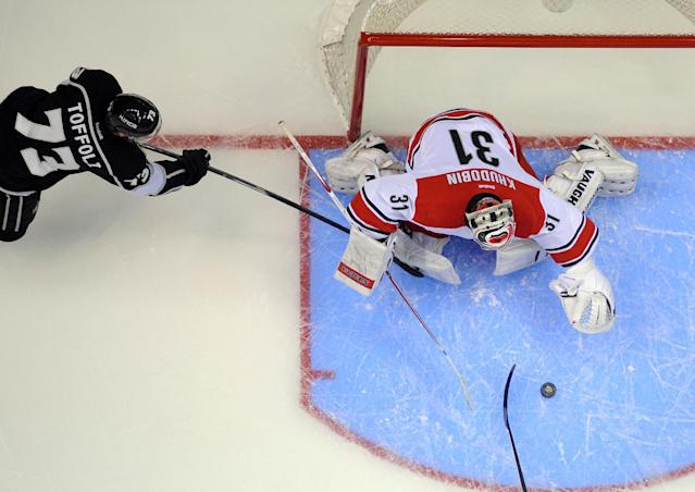 Los Angeles Kings center Tyler Toffoli, left, tries to get a shot in on Carolina Hurricanes goalie Anton Khudobin, of Kazakhstan, during the first period of an NHL hockey game, Saturday, March 1, 2014, in Los Angeles. (AP Photo/Mark J. Terrill)