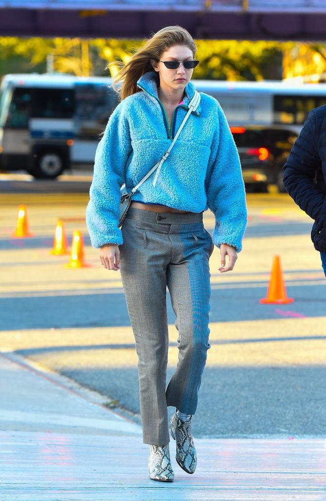 Gigi Hadid was recently photographed out and about in a £350 blue fuzzy zip-up by Sandy Liang [Photo: Getty]