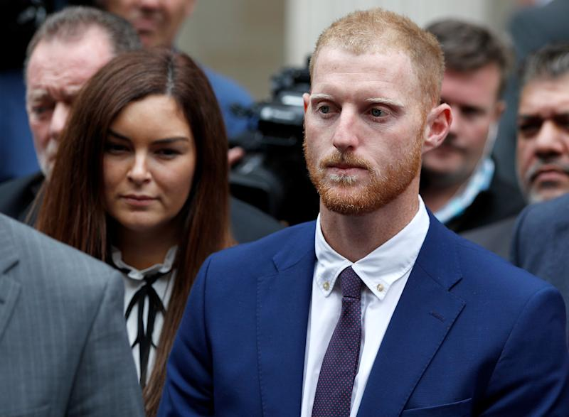 England cricket player Ben Stokes listens as his lawyer reads a statement outside Bristol Crown Court after he was acquitted of affray in Bristol, Britain, August 14, 2018. REUTERS/Peter Nicholls
