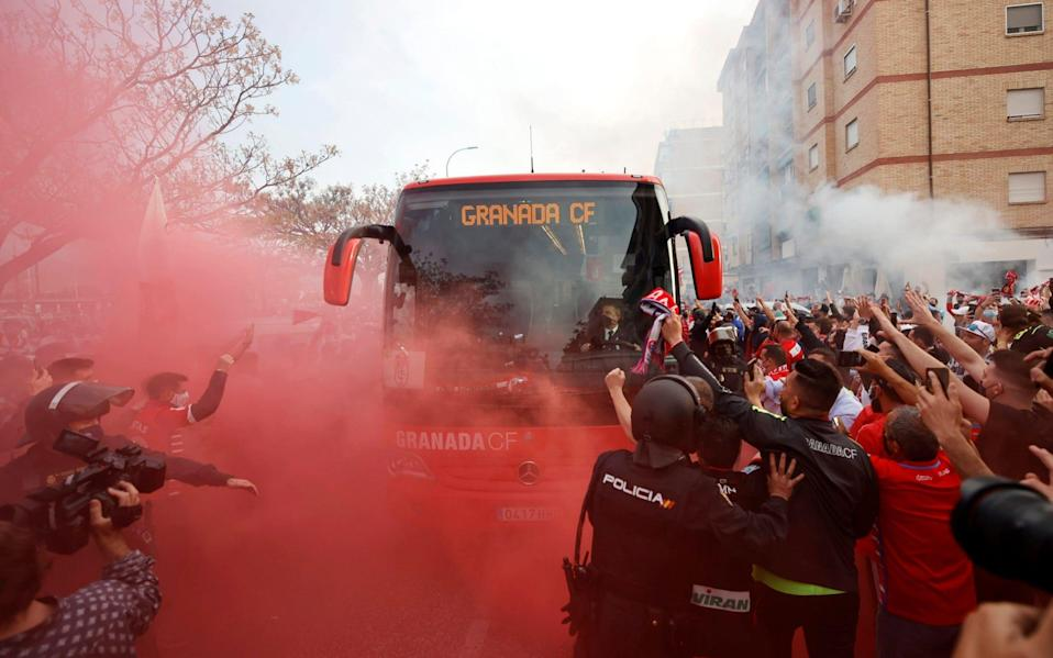 Granada fans cheers and set off smoke grenades as the team bus arrives ahead of the Europa League, quarterfinal, first leg soccer match between Granada and Manchester United - AP