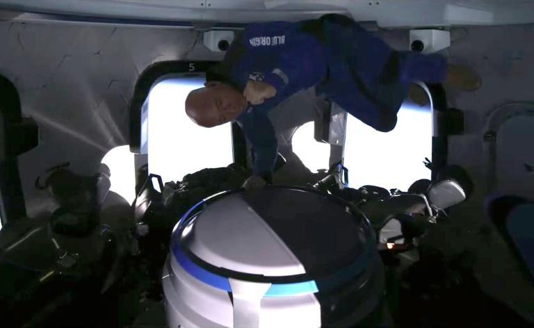 This still image taken from video by Blue Origin shows the space company's founder Jeff Bezos celebrating catching popcorn in his mouth during the space flight