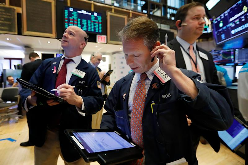 Trader Robert Charmak, center, works on the floor of the New York Stock Exchange, Tuesday, Feb. 12, 2019. U.S. stocks are gaining in early trading after U.S. lawmakers reached a tentative deal to avoid another costly government shutdown. (AP Photo/Richard Drew)