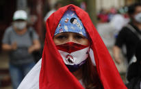 Nurses from the National Hospital protest for better salaries and security gear amid the COVID-19 pandemic outside the Economy Ministry in Asuncion, Paraguay, Monday, Oct. 26, 2020. (AP Photo/Jorge Saenz)