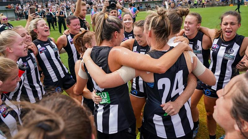 Collingwood players celebrate their AFLW round one victory over newcomers West Coast