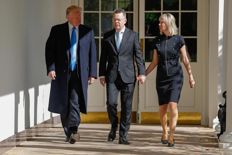 Andrew Brunson and his wife walk with Donald Trump.