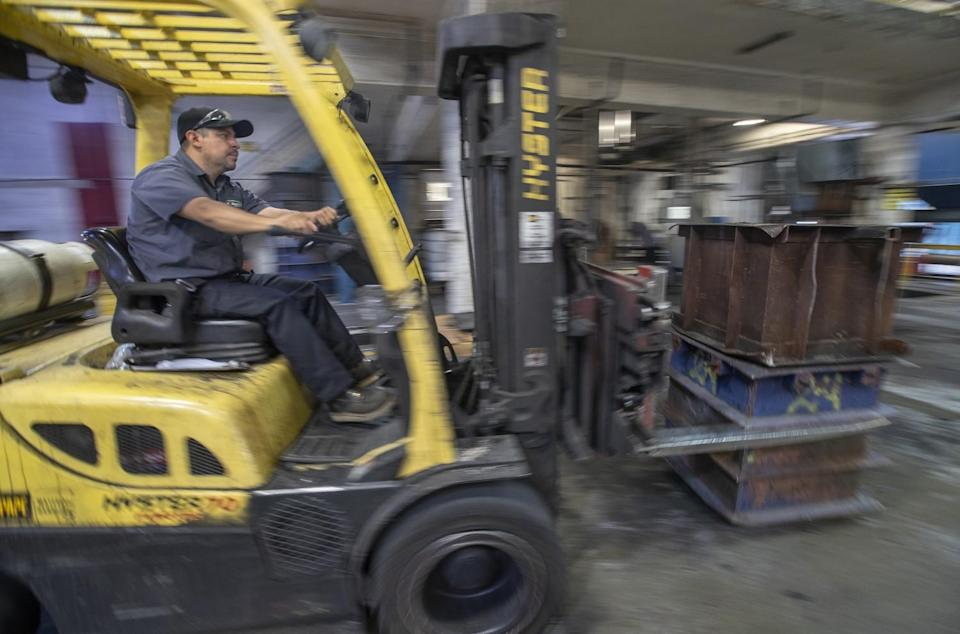 Carlos Arceo, 39, a 2nd shift manager at U.S. Rubber Recycling, operates a fork lift inside the production floor.