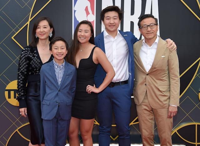 Taiwanese/Canadian businessman Joe Tsai (R), his wife Clara Wu (L) and children Dash Tsai, Jacob Tsai and Alex Tsai arrive for the 2019 NBA Awards at Barker Hangar on June 24, 2019 in Santa Monica, California. (Photo by LISA O'CONNOR / AFP) (Photo credit should read LISA O'CONNOR/AFP/Getty Images)