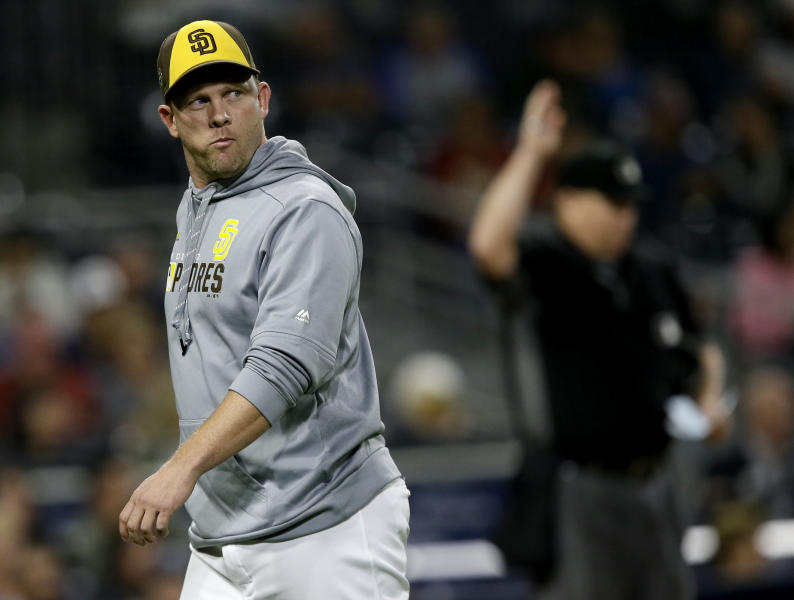 San Diego Padres manager Andy Green walks off the field during the eighth inning of the team's baseball game against the Arizona Diamondbacks in San Diego, Friday, Sept. 20, 2019. (AP Photo/Alex Gallardo)