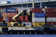 A shipping container is moved along the Delaware River in Philadelphia, Wednesday, Sept. 29, 2021. With three months until Christmas, toy companies are racing to get their toys onto store shelves as they face a severe supply network crunch. Toy makers are feverishly trying to find containers to ship their goods while searching for new alternative routes and ports. (AP Photo/Matt Rourke)
