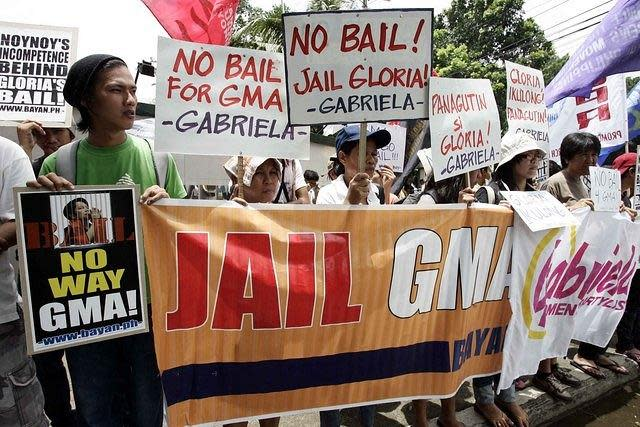 Militant activist rally infront of Philippine Veterans hospital, after Regional trial court of Pasay allows former President Gloria Macapagal Arroyo to post bail on 25 July 2012. (Mike Alquinto/NPPA Images)