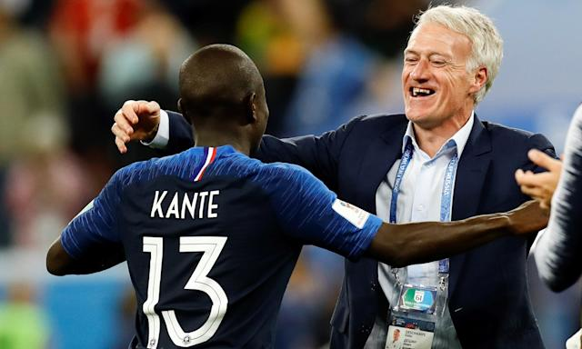Didier Deschamps embraces N'Golo Kanté after France's victory over Belgium in the World Cup semi-final.