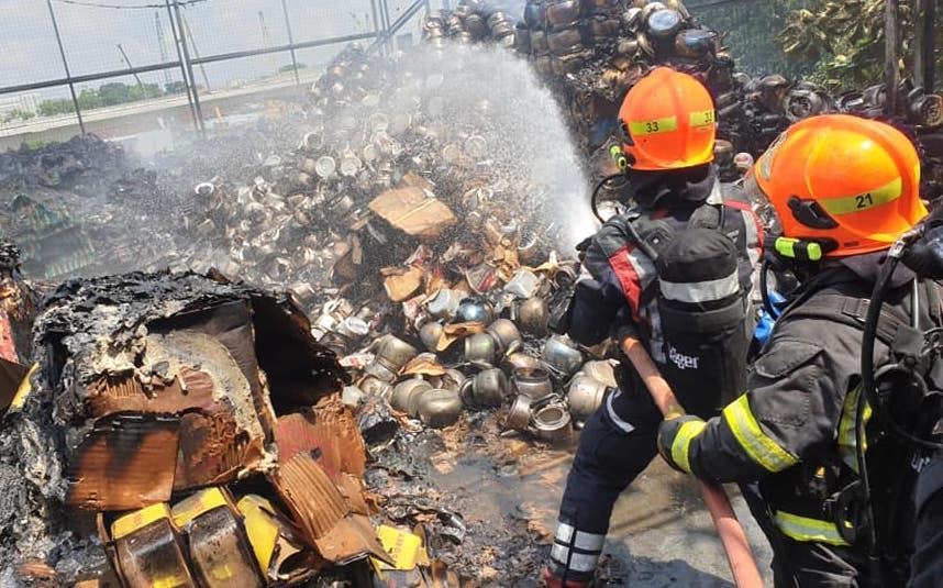 "SCDF said the fire was ""raging at the rooftop"" and ""threatening to spread"" when its officers arrived at the scene."