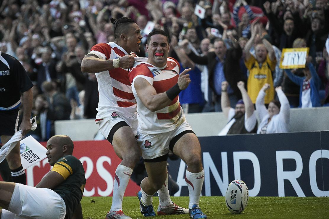 TO GO WITH AFP STORY BY PIRATE IRWIN (FILES) A file photo taken on September 19, 2015 shows Japan's wing Karne Hesketh (R) as he celebrates scoring the winning try in the dying moments of the Pool B match of the 2015 Rugby World Cup between South Africa and Japan at the Brighton community stadium in Brighton, south east England. Japan won 34-32. AFP PHOTO / LIONEL BONAVENTURE RESTRICTED TO EDITORIAL USE, NO USE IN LIVE MATCH TRACKING SERVICES, TO BE USED AS NON-SEQUENTIAL STILLSTO GO WITH AFP STORY BY PIRATE IRWIN (FILES) A file photo taken on September 19, 2015 shows Japan's wing Karne Hesketh (R) as he celebrates scoring the winning try in the dying moments of the Pool B match of the 2015 Rugby World Cup between South Africa and Japan at the Brighton community stadium in Brighton, south east England. Japan won 34-32. AFP PHOTO / LIONEL BONAVENTURE RESTRICTED TO EDITORIAL USE, NO USE IN LIVE MATCH TRACKING SERVICES, TO BE USED AS NON-SEQUENTIAL STILLS (AFP Photo/LIONEL BONAVENTURE)