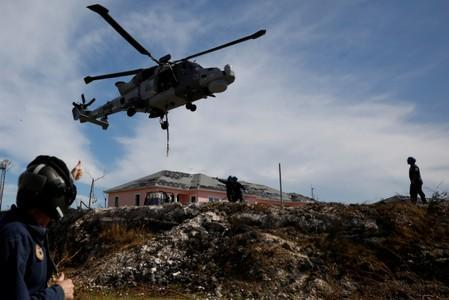 A Royal Navy helicopter takes off outside Marsh Harbour Healthcare Center after Hurricane Dorian hit the Abaco Islands in Marsh Harbour