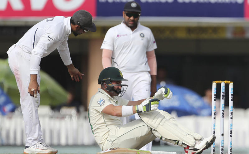 South Africa's Dean Elgar shows signs of discomfort after being hit on head courtesy an Umesh Yadav delivery. Elgar, who scored 16 runs, was replaced by concussion substitute Theunis de Bruyn. AP