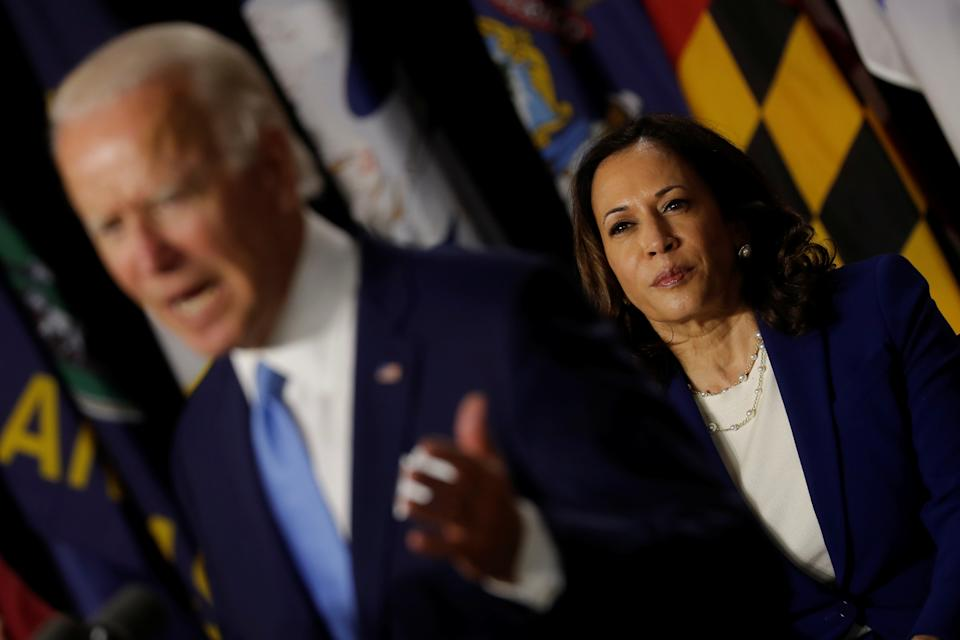 Democratic vice presidential candidate Senator Kamala Harris listens as presidential candidate and former Vice President Joe Biden speaks at a campaign event, their first joint appearance since Biden named Harris as his running mate, at Alexis Dupont High School in Wilmington, Delaware, U.S., August 12, 2020. REUTERS/Carlos Barria