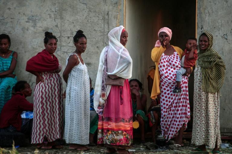 The United Nations rights chief Michelle Bachelet has warned of possible war crimes in Ethiopia's Tigray; these women were photographed on November 13 having fled into neighbouring Sudan