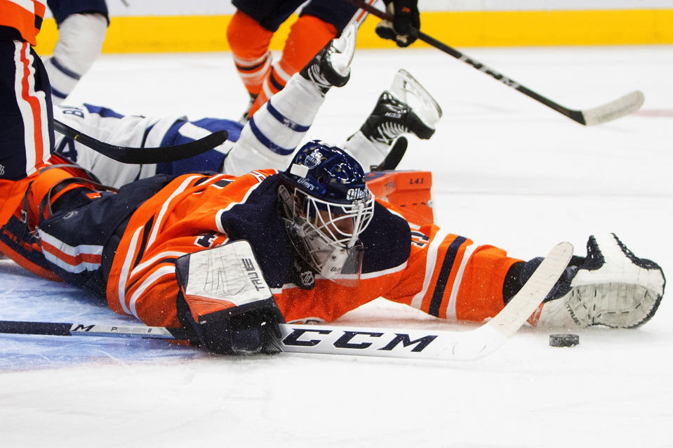 Edmonton Oilers goalie Mike Smith (41) makes the save against the Toronto Maple Leafs during the first period of an NHL game in Edmonton, Alberta, on Saturday, Feb. 27, 2021. (Jason Franson/The Canadian Press via AP)