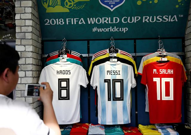 A customer take picture of soccer uniforms at soccer shop KAMO in Tokyo, Japan May 17, 2018. REUTERS/Kim Kyung-Hoon