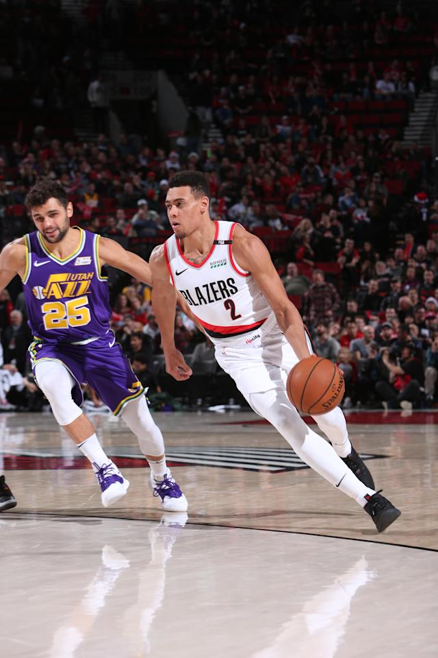 PORTLAND, OR - DECEMBER 21: Wade Baldwin IV #2 of the Portland Trail Blazers drives to the basket against the Utah Jazz on December 21, 2018 at the Moda Center Arena in Portland, Oregon. (Photo by Sam Forencich/NBAE via Getty Images)
