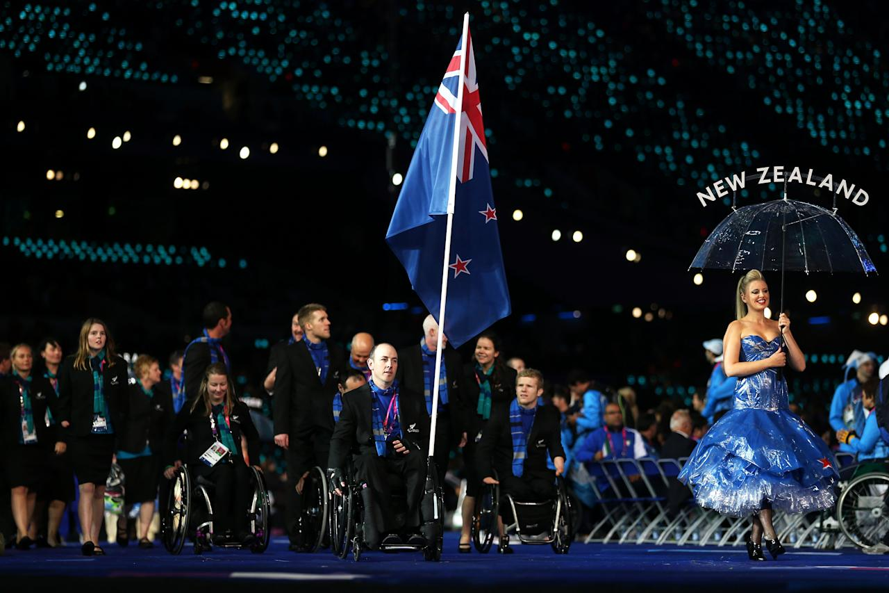 LONDON, ENGLAND - AUGUST 29:  Shooter Michael Johnson of New Zealand carries the flag during the Opening Ceremony of the London 2012 Paralympics at the Olympic Stadium on August 29, 2012 in London, England.  (Photo by Clive Rose/Getty Images)