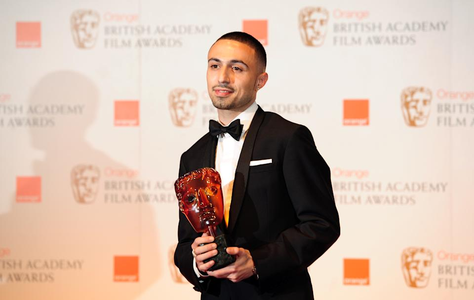British actor Adam Deacon poses with the Rising Star Award at the BAFTA British Academy Film Awards at the Royal Opera House in London on February 12, 2012.  AFP PHOTO / LEON NEAL (Photo credit should read LEON NEAL/AFP via Getty Images)