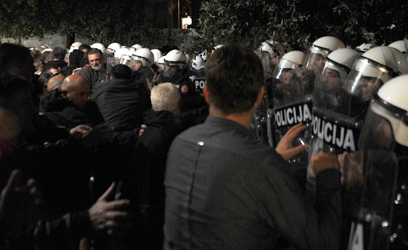 Montenegro's opposition protesters scuffle with police on October 17, 2015 in Podgorica