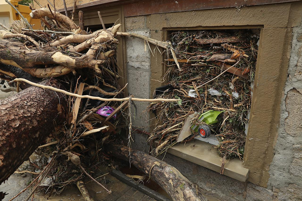 <p>A child's toy and bits of smashed trees are wedged into a window in Braunsbach, Germany, on May 30, 2016, after a flash flood hit the town. (Sean Gallup/Getty Images) </p>