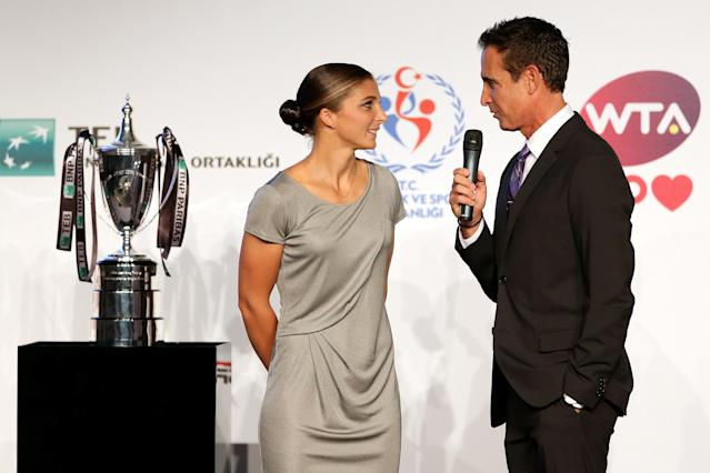 ISTANBUL, TURKEY - OCTOBER 20: Sara Errani of Italy is interviewed by Master of Ceremonies Andrew Krasny during the draw ceremony for the WTA Championships at the Renaissance Polat Hotel on October 20, 2013 in Istanbul, Turkey. (Photo by Matthew Stockman/Getty Images)