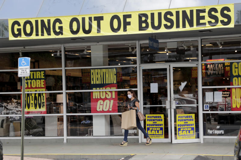 FILE - In this Aug. 6, 2020, file photo, a customer leaves a Pier 1 retail store, which is going out of business, during the coronavirus pandemic in Coral Gables, Fla. The Labor Department reported unemployment numbers Thursday, Sept. 3. (AP Photo/Lynne Sladky, File)