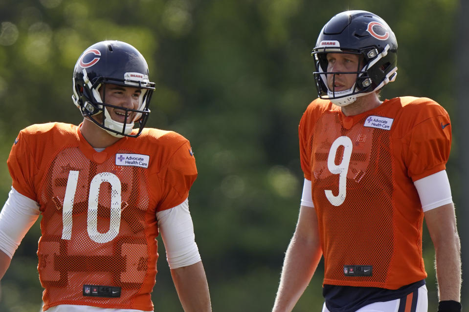 FILE - In this Aug. 17, 2020, file photo, Chicago Bears quarterbacks Mitchell Trubisky, left, and Nick Foles walk on the field during an NFL football camp practice in Lake Forest, Ill. The Bears acquired Super Bowl 52 MVP Foles to compete with former No. 2 draft pick Trubisky for the starting quarterback job, one of several moves to shake up an offense that ranked among the NFL's worst last season. (AP Photo/Nam Y. Huh, File)