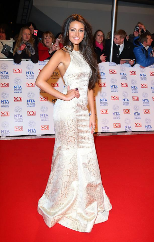 Michelle Keegan looked phenomenal in this white, lace detailed gown. Copyright [getty]