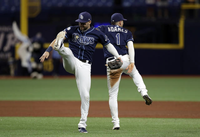 Tampa Bay Rays center fielder Kevin Kiermaier and shortstop Willy Adames (1) celebrate after the team's win over the Baltimore Orioles during the second baseball game of a doubleheader Tuesday, Sept. 3, 2019, in St. Petersburg, Fla. (AP Photo/Chris O'Meara)