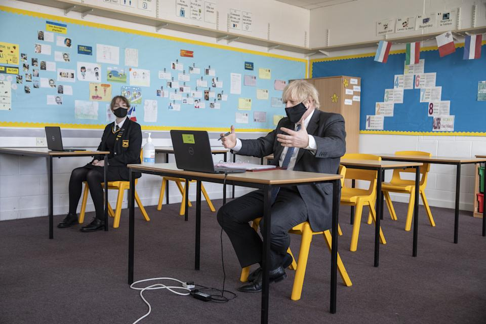 Prime Minister Boris Johnson takes part in an online class during a visit to Sedgehill School in Lewisham, south east London, to see preparations for students returning to school. Picture date: Tuesday February 23, 2021.
