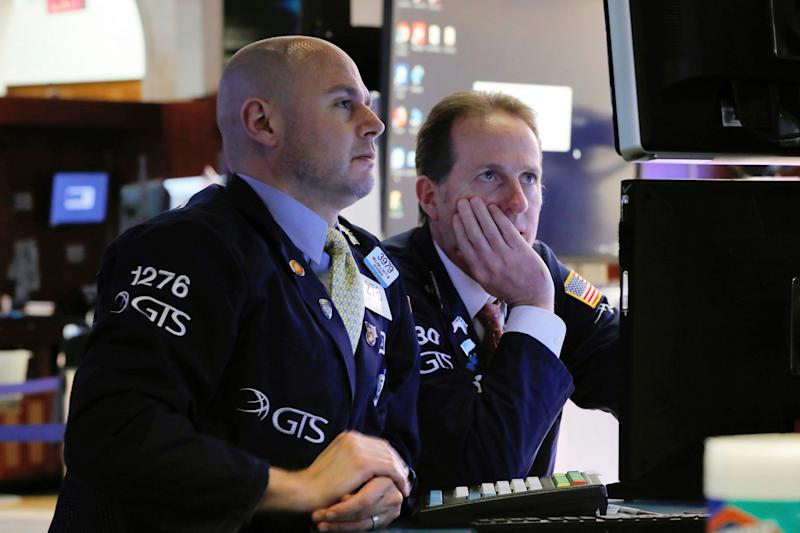 FILE- In this Jan. 30, 2019, file photo specialists Mario Picone, left, and Glenn Carrell work on the floor of the New York Stock Exchange. The U.S. stock market opens at 9:30 a.m. EST on Monday, Feb. 4. (AP Photo/Richard Drew, File)